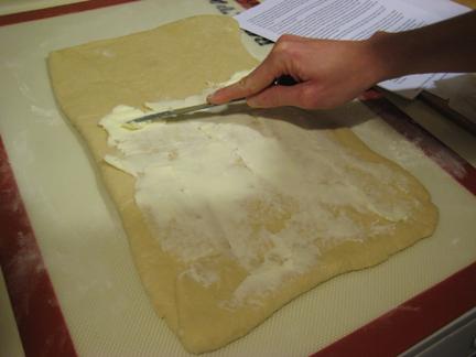 Pain au chocolat dough: spread the butter