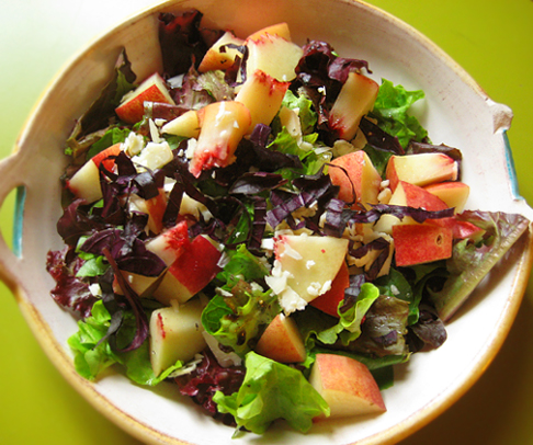 Salad with white peaches, garlic & chives cheese and purple basil