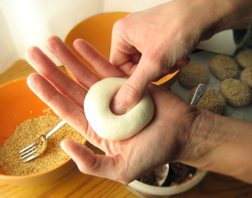 Sesame balls, pressing a hole in the dough