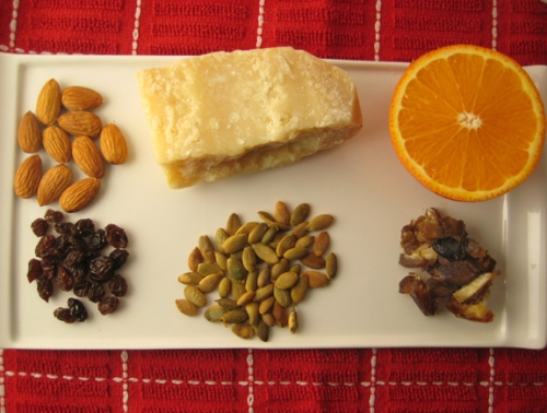 Almonds, Parmesan cheese, oranges, raisins, pumpkin seeds, dates