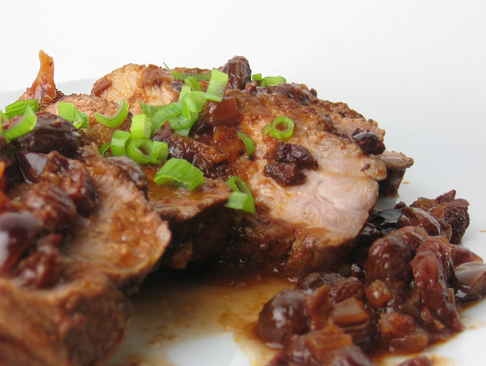 Roasted pork with tomato, olive, raisin, and balsamic vinegar sauce