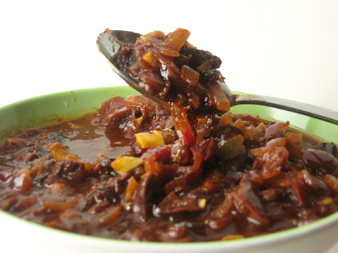 Sauce made with tomato juice, balsamic vinegar, olives, and raisins