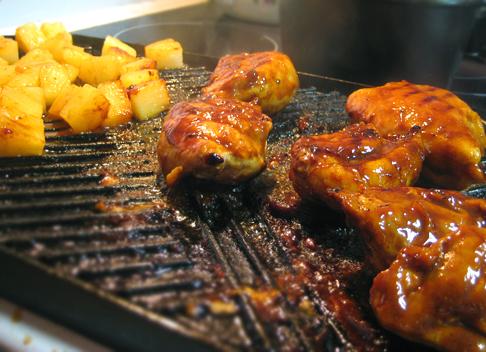 Grilling huli huli chicken