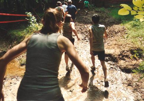 Running through mud at the warrior dash