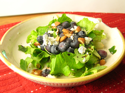 Salad with blueberries, goat cheese, roasted almonds, basil, and mint
